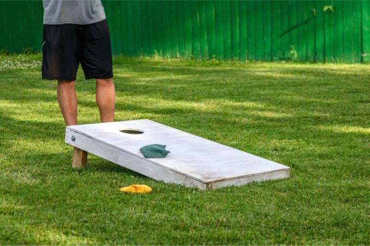 Playing a game of cornhole