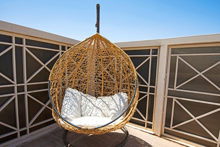 Hanging egg chair on terrace area