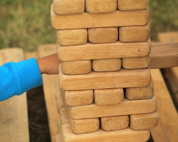 Playing a game of outdoor Jenga