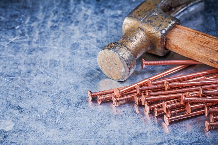 Copper nails with hammer
